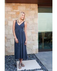 Dress like a goddess in the Goddess Maxi Dress, inspired by details from ancient Greek dresses. With slight gathers on the straps, a drawstring waist to flatter and an asymmetrical layer draped around the front and back, this is the maxi dress you've been waiting for. 100% lightweight rayon lycra, asymmetrical drape around front and back, slight gather on front of straps, smocked center back bodice, v-neck, made in USA.