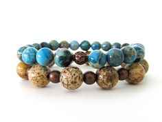 Very cool women's beaded stretch bracelet stack with 8mm teal impression jasper beads, 10mm picture jasper beads and antiqued copper accent beads.