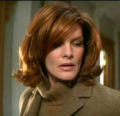 """Rene Russo in """"The Thomas Crown Affair"""". Love her hair!"""