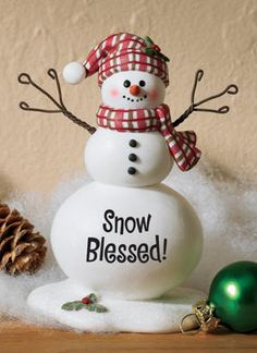 "'Snow Blessed' Snowman Figurine  Surprise someone you care about this Christmas season with this adorable little 'Snow Blessed' Snowman. Leave him on their desk at work or their nightstand to cleverly remind them of their many blessings! 4.5"" tall, Gift Packaged. (Item #31445) $7.95"