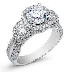Amazing diamond-encrusted halo engagement ring - Round center with half moon accents!  #engagement #engagementrings #jewelry #artdeco #weddings #uniqueengagementrings $4199