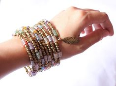 Saree (wire bracelet, gypsy inspired, feather charm, ethnic inspired) on Etsy, $10.00