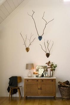 Branch antlers ... something similiar on NATE ... UPCYCLE . take wooden black, used gold spray paint, can screw branch from back from cordless screwdriver