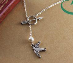 Mockingjay necklace with Katniss' arrow & Peeta's pearl <3... WANT!!!