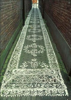 painted lace carpet on brick walkway