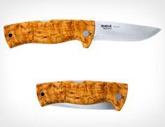 wood grip, pretty dope.. norway steel