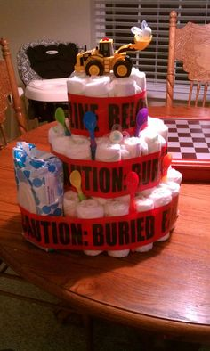 Caution tape diaper cake for construction baby shower!