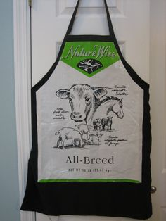 This apron is made from a recycled plastic feed bag that is stitched onto a black premade apron