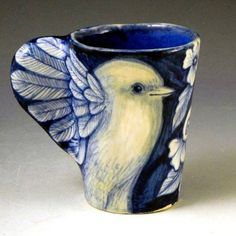 Such a sweet cup with bird wing handles.