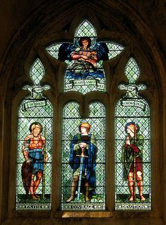 Stained glass window to a design by Edward Burne-Jones and made by Morris & Co. Installed in Malmesbury Abbey. The window shows characteristic themes based on Arthurian legends. Four of the founders of Morris & Co were original members of The Artists Rifles.
