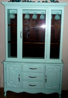 Leave the inside dark stain? Aqua Light Blue China Cabinet.  This was a dark red before!