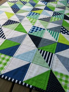 Geometric Navy and Lime Handmade Modern Cot Crib Patchwork Quilt with white in triangles for Baby Nursery. $116.00, via Etsy.