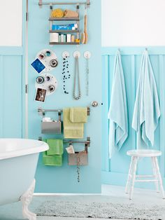 Not a lot of shelving in your apartment bathroom? Put the back of the door to use! Dollar store hooks