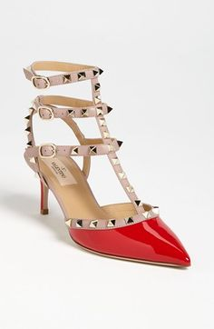 studded with a pop of red / valentino