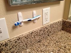 Use two command hooks to hold a toothbrush but inside medicine cabinet to free up cabinet space