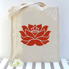 Yoga Tote Bag featuring a lovely lotus flower design hand printed in warm red. An ideal gift for yoga loving friends and great for yoga class, (it will fit about two thirds the length of a standard sized yoga mat when it's rolled up, so about 19cm will show above the top of the bag).