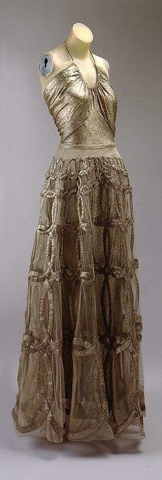 Dress, Evening  Madeleine Vionnet  (French, Chilleurs-aux-Bois 1876–1975 Paris)  Date: fall/winter 1938–39 Culture: French Medium: metal thread Dimensions: [no dimensions available] Credit Line: Gift of Mrs. Harrison Williams, Lady Mendl, and Mrs. Ector Munn, 1946