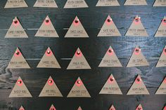 triangle escort cards, photo by Studio Castillero http://ruffledblog.com/modern-ace-hotel-wedding #weddingideas #seatingchart #escortcards
