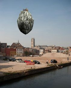 The Kurdish/Turkish artist Ahmet Ogüt has made this incredible installation for the Belgian art festival, TRACK taking place in Ghent. The work consists of a floating mountaintop castle perched on top of a helium balloon.