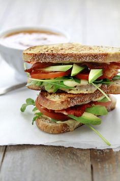 Grilled Cheese with Tomato, Avocado, and Arugula.