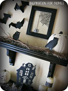 remove the back of a black picture frame and place  Martha Stewart spider web clings on the glass