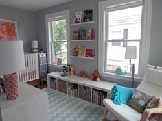 like this layout. the low bookshelf. the book trays on the wall. chair in corner. dresser with changing pad.