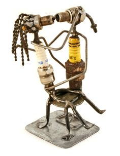 The entire sculpture is made from recycled auto spark plugs. Cute and creative! From Burkina Faso. #giftideasforhim #burkinafaso #sparkplugs #kissing  http://www.swahilimodern.com/products/spark-plug-lovers