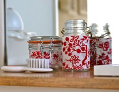 fabric wrapped bathroom jars. Use leftover fabric scraps, and decorate the jar