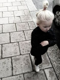 Too Cute! all black, chucks and top knot. yup.