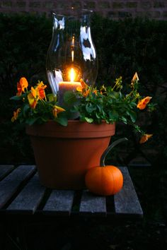 Fall Candle planters.  Why didn't I think of this?  Very neat!