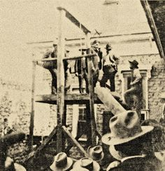 Augustine Chacon's hanging on November 14 was a big occasion; a 14-foot adobe wall was built around the scaffold so that only those with invitations could view the execution. While walking up the steps of the scaffold (shown here), he shook the hands of admirers who would soon watch him drop to his death.  – Courtesy True West Archives –