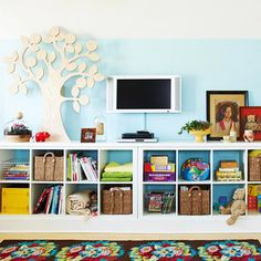IKEA's expedit bookcases.  Room to store larger toys on top and hang family photos and display children's artwork above