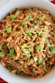 Simple Asian Soy-Peanut Noodles - we have made these TWICE this week - we can't get enough of them! The original recipe was a little too salty for me so we added extra honey and peanut butter ... SO Delicious!!
