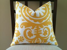 suzani slub in yellow - I'm pretty set on covering my ottoman with this fabric!