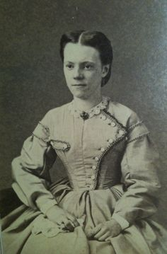 Young woman with asymmetrical bodice. American.