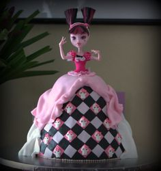 Dead tired - Draculaura - Monster High Doll cake for my little neighbour who was turning 10.  This is Draculaura....lol the daughter of Dracula.  Had heaps of fun doing this cake (even though I had no idea what I was doing)...was happy with the finished product.  Cake is chocolate mud cake iced with chocolate ganache and covered in fondant.  All accents fondant....