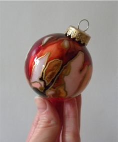 This one-of-a-kind, hand-painted glass ornament is an heirloom in the making.