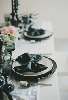 Black napkins folded to look like bow ties! So classy - for more ideas and inspiration like this, visit us at www.theweddingbelle.net