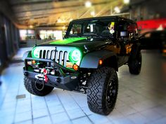 SOLD: 2012 Modified Jeep Wrangler at Derrick Dodge Chrysler Jeep Ram in Edmonton, Alberta.  Features include: 4 inch zone lift kit, 315/70/17 goodyear duratrac tires, Fuel rims, Black and manchined throttle, Smittybilt xrc front bumper, Smittybilt xrc rear bumper with swing away tire carrier, Smittybilt x20 8 comp winch, Piaa 510 atp lights,  Oracle green head light inserts, Custom green decal pkg &   Custom green dash kit    For more information please contact us.