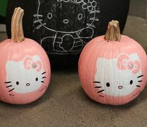 """Cute painted Hello Kitty pumpkins. Paint the pumpkin pink, allow to dry. Then use a sketch to trace the kitty pattern on. Paint Kitty white. Add black whiskers, eyes, and outline nose. Paint on bow. Add """"bling"""" to center of the bow. Ta-da! :)"""