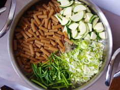 One pot pasta with zucchini, leeks, and garlic scapes - and a white wine lemon sauce. Everything cooks in one pot!