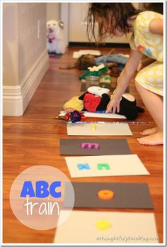 ABC train: have kids set out 26 pieces of paper with one letter of the alphabet on each, then have them do a scavenger hunt thru the house {or outside} to find one item that starts with that letter--teamwork is encouraged!   Fun and easy way to keep them occupied for a bit.  :)  Great for babysitting!