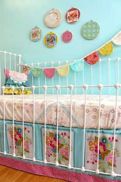 i LOVE this! shabby chic vintage nursery, bright vivid colors - sooo cute!