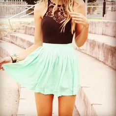 Back laced shirt and high waisted turquoise skirt