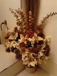 $Tree floral arrangement, $5 ($8 if you include the vase, rafia, & shredded grass filler/ had some eucalyptus already)