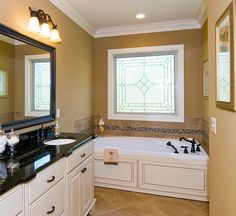 Bring in plenty of daylight while maintaining privacy in the master bathroom. Opt for an elegant frosted glass design instead of regular windows! Pictured is the Runnymeade Plan 1164 http://www.dongardner.com/plan_details.aspx?pid=3402 #Small #Home #Designs #Bathroom