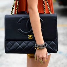 If I only ever own just ONE piece of couture, it would absolutely be a black quilted leather Chanel handbag. Please please please!!!
