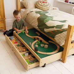 Train storage under the bed.