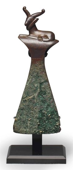 A BACTRIAN COPPER AXE HEAD CIRCA LATE 3RD-EARLY 2ND MILLENNIUM B.C. | Christie's