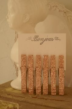 DIY Glitter Clothes Pegs - This simple DIY Glitter Clothes Pegs is one of the easiest ways to add glitter to your wedding when used as seating cards, napkin holders or wedding favors.